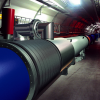 Reports to be given today by LHC for particle existence